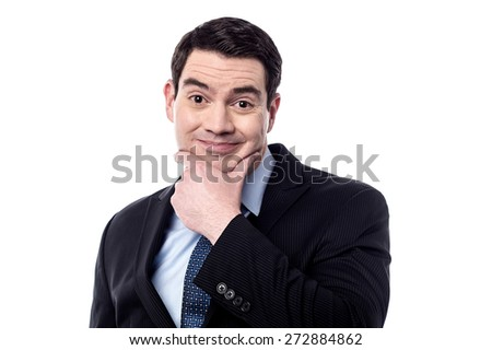 Thoughtful businessman with hand on chin - stock photo