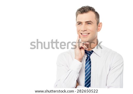 Thoughtful businessman with hand on chin over white