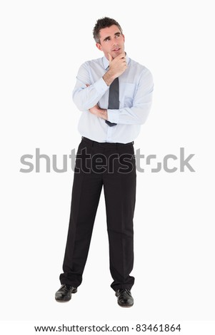 Thoughtful businessman with his hand on his chin against a white background - stock photo