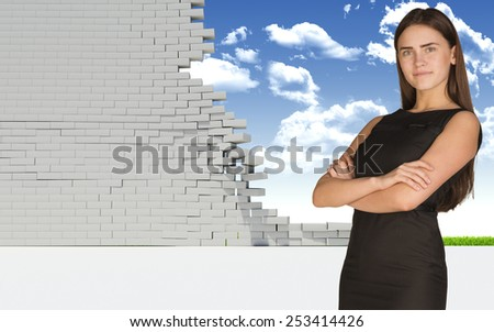 Thoughtful businesswoman in dress with crossed arms looking at camera. Dilapidated brick wall, green meadow and sky as backdrop. Concept of freedom - stock photo