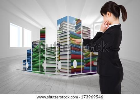Thoughtful businesswoman pointing against bright room with opened windows