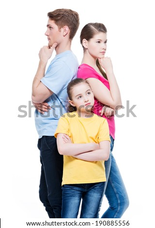 Thoughtful family with daughter standing back to back at studio -  isolated on white.
