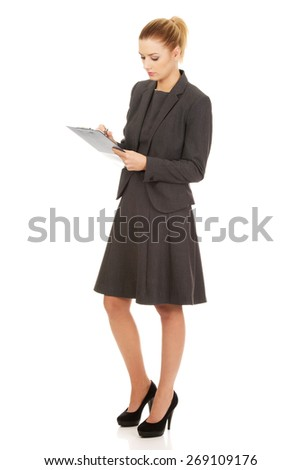 Thoughtful focused businesswoman reading her notes. - stock photo