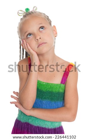 Thoughtful girl looking up. The girl is six years old. - stock photo