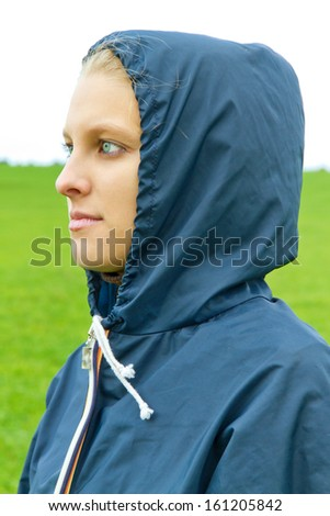 Thoughtful girl on a rainy day - stock photo