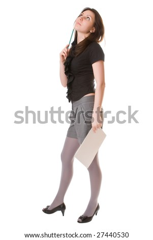 Thoughtful girl with a notebook and a pencil isolated on a white background