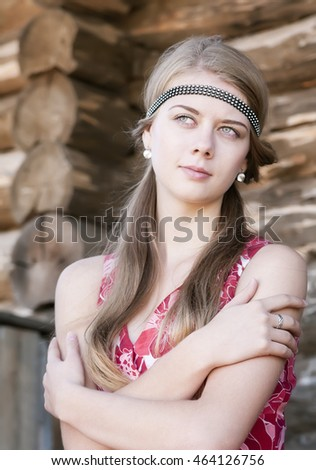 Thoughtful girl with crossed arms on chest