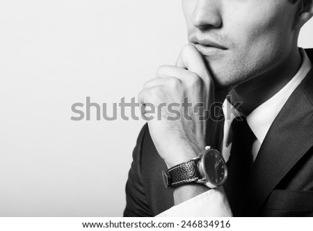 Thoughtful handsome man - stock photo