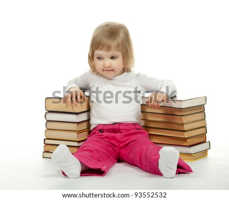 Thoughtful  little girl sitting among books; white background