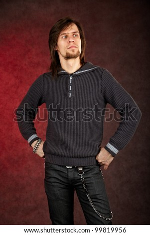 Thoughtful man looking up on dark background - stock photo