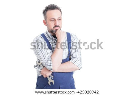 Thoughtful man portrait with young mechanic in blue overall looking worried with copyspace isolated on white - stock photo
