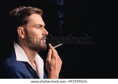 Thoughtful man relaxing with cigarette