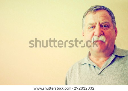 Thoughtful mature man portrait. Grunge stye