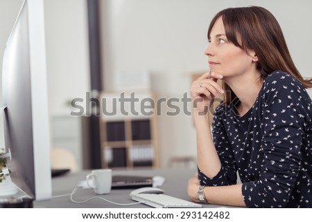 Thoughtful Office Lady Sitting at her Worktable and Leaning on her Elbow While Looking Up in a Deep Thinking Expression. - stock photo