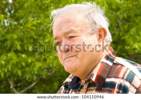 thoughtful old man - stock photo