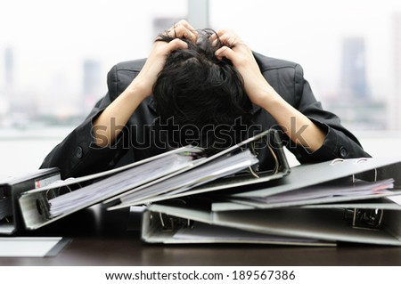 Thoughtful or stressful businessman at work - stock photo