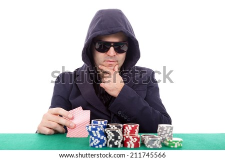 Thoughtful poker player isolated on a white background