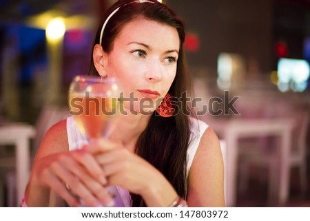 Thoughtful pretty woman in restaurant