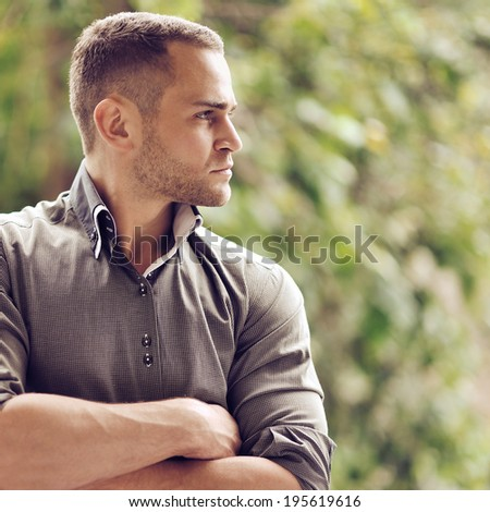 Thoughtful serious man outdoors portrait