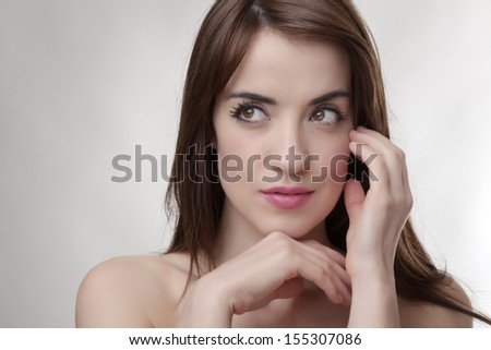Thoughtful sexy brunette model eyes looking to the side - stock photo
