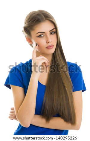 Thoughtful sexy young lady looking at the camera with her finger on her cheek on white background. - stock photo