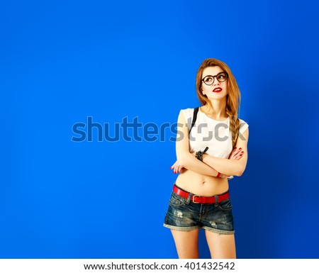 Thoughtful Student Hipster Girl Looking Up - stock photo