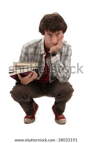 Thoughtful student with books, crouching - stock photo