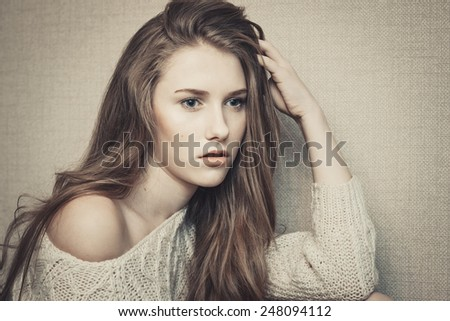 Thoughtful teenage girl looking confused about problems  - stock photo