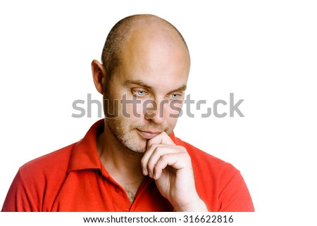 Thoughtful unshaven man on a white background - stock photo