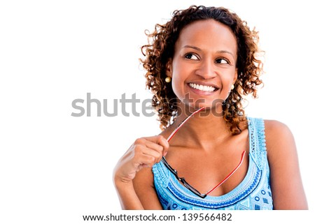 Thoughtful woman portrait smiling - isolated over a white background - stock photo
