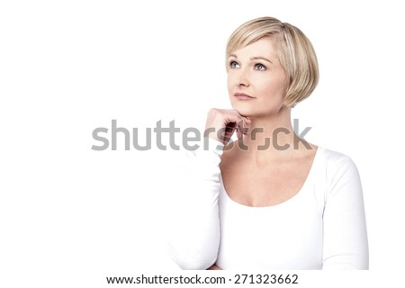 Thoughtful woman with her hand on chin - stock photo