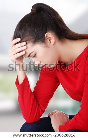 Thoughtful woman with problem or depression - stock photo