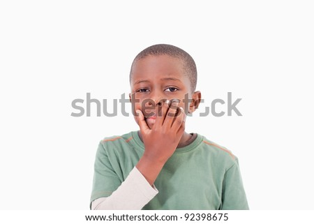Thoughtful young boy against a white background - stock photo