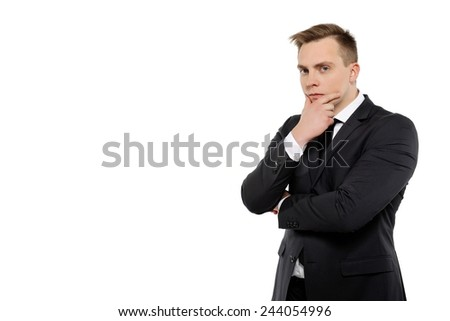 Thoughtful young business man looking at camera.  - stock photo