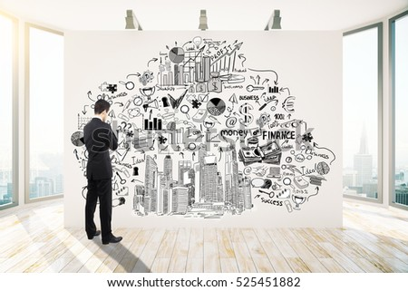 Thoughtful young businessman in bright interior looking at creative business sketch on wall with lamps. Success concept. 3D Rendering
