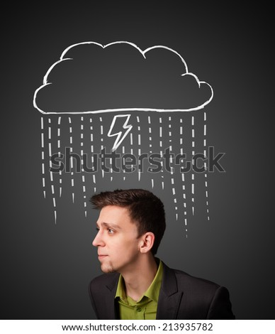 Thoughtful young businessman with thundercloud above his head - stock photo