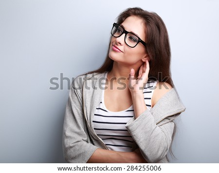 Thoughtful young casual woman looking on empty copy space. Closeup portrait - stock photo