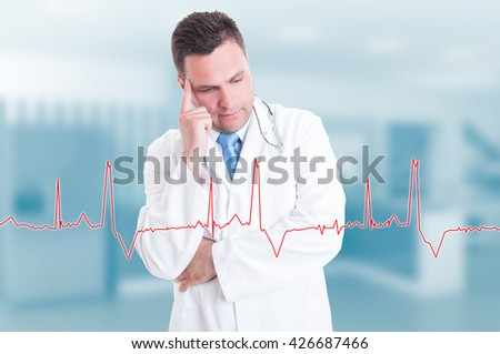 Thoughtful young doctor with heartbeat graph on screen in front of him as electrocardiogram concept - stock photo