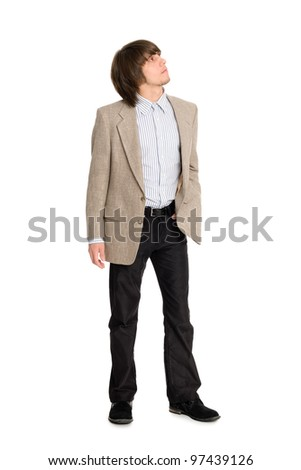 Thoughtful young man looking up - stock photo