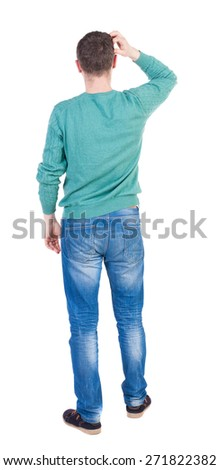thoughtful young man. Rear view people collection.  backside view of person.  Isolated over white background. - stock photo
