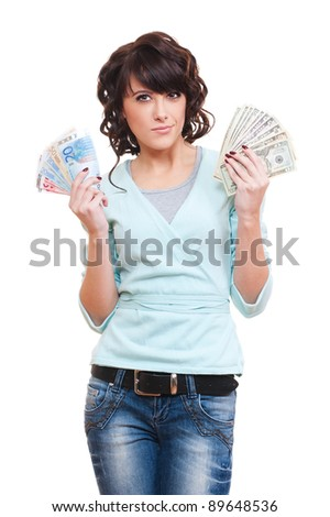 thoughtful young woman holding dollars and euro in her hands. isolated on white background