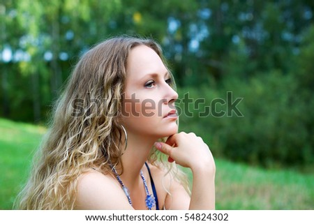 Thoughtful young woman looking away. - stock photo