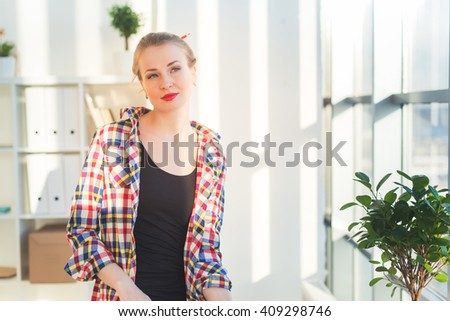 Thoughtful young woman sitting at a light room in the morning, bowed her shoulder, dreaming. Relaxed female blonde girl looking aside, front view portrait. - stock photo