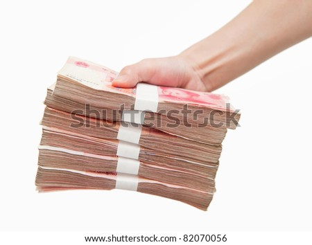 Thousands china's currency one hundred RMB yuan in hand isolated on white