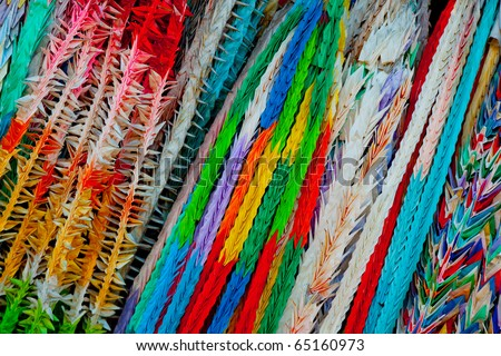 thousands of colorful oragami cranes hanging in a temple in Tokyo, Japan - stock photo