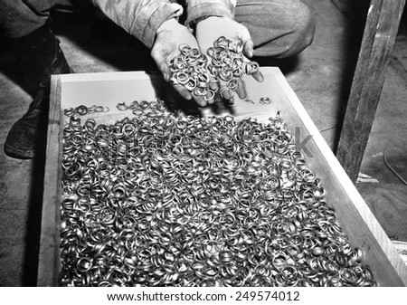 Thousands of gold wedding rings removed from victims of the Nazi German concentration camps. U.S. troops found jewelry and gold fillings, near Buchenwald concentration camp. May 5, 1945 - stock photo