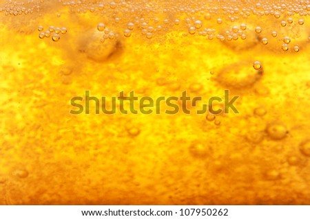 Thousands of small bubbles in beer. - stock photo