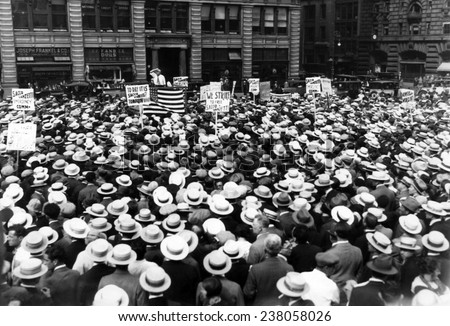 Thousands of union members attending a one hour protest strike and meeting in Union Square prior to violence erupting New York City July 16 - stock photo