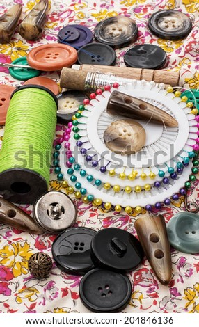 thread,button,crochet hook - stock photo