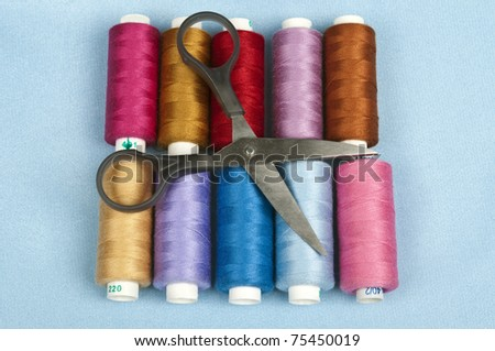 Thread on blue material background